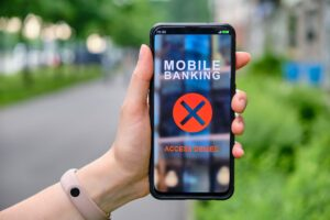 mobile-banking-interface-with-access-denied-in-smartphone-and-holding-by-hand